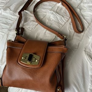 Handbags - Brown leather purse with detailed buckle